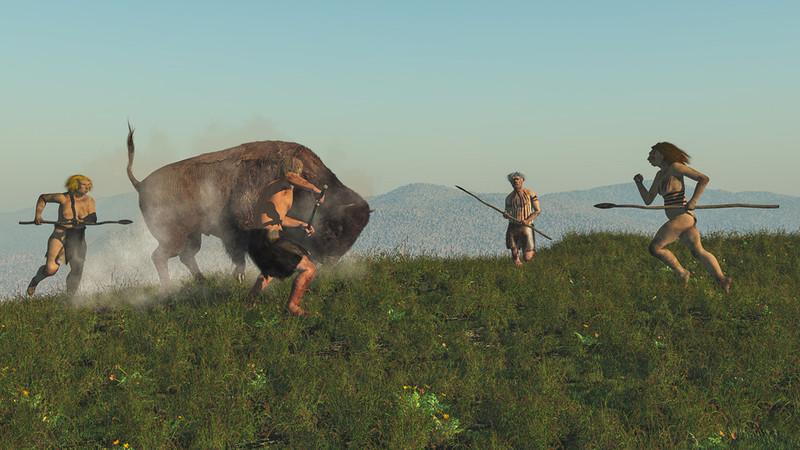 Hombres del neolítico cazando un bisonte- Fotolia