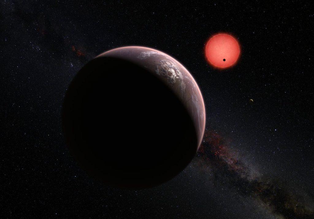 Estrella enana ultrafría TRAPPIST-1 y uno de sus planetas- ESO/M. Kornmesser/N. Risinger